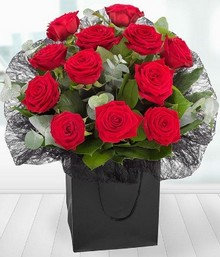 gift bag with 12 red roses.